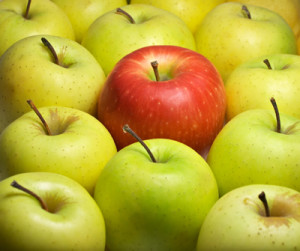red apple among golden ones representing content marketing