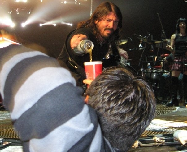Dave Grohl pouring a beer