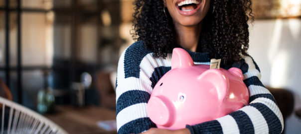 woman holding bank to show marketing budget guide