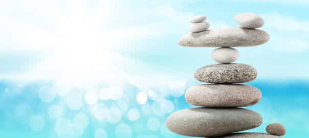 Stacked pebbles with an aqua background representing a balanced martech stack.